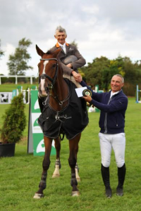Taylor Presenting Francis with his winning rosette in the Mervue Equine LST 2016